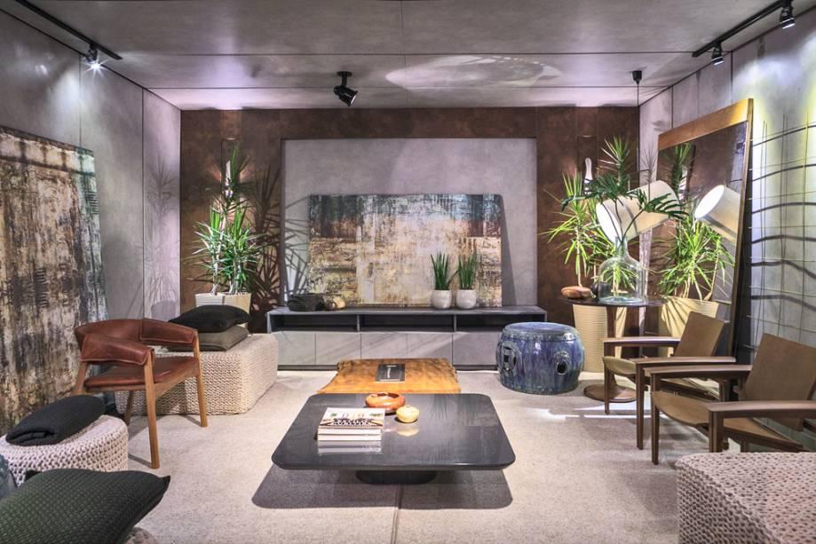 CASACOR Paraná 2017.<span>Lounge Rio Quente - Michelle Felicetti e Rodrigo Garcia.A iluminação cênica, o MDF com aparência de concreto aplicado às paredes e o painel de aço corten refletem a sutil referência industrial do projeto.</span>