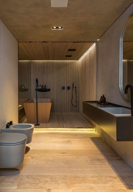 No banheiro criado pela Triplex Arquitetura (Loft do Designer), a madeira que vai do chão ao teto, também está presente na banheira e é a responsável pelo clima de aconchego por lá.