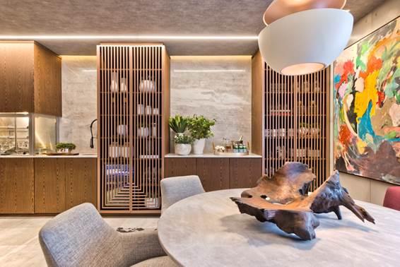 Sala de Almoço - Samara Barbosa. A madeira natural combinada ao mármore e ao concreto proporcionam uma sensação moderna e sofisticada ao ambiente, perfeito para receber.