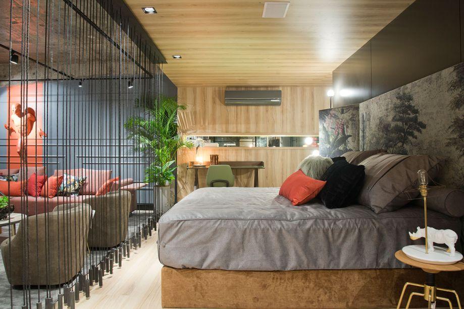 Estúdio Contemporâneo - Kel Oliveira. Um ninho, representado por uma caixa de madeira dentro de um espaço de concreto, foi o conceito inicial de Kel Oliveira. Com 100 m², a ampla sala, que tem teto com uma pegada industrial, é integrada com cozinha. Na suíte, o destaque fica por conta da madeira, presente no piso, teto e parede.