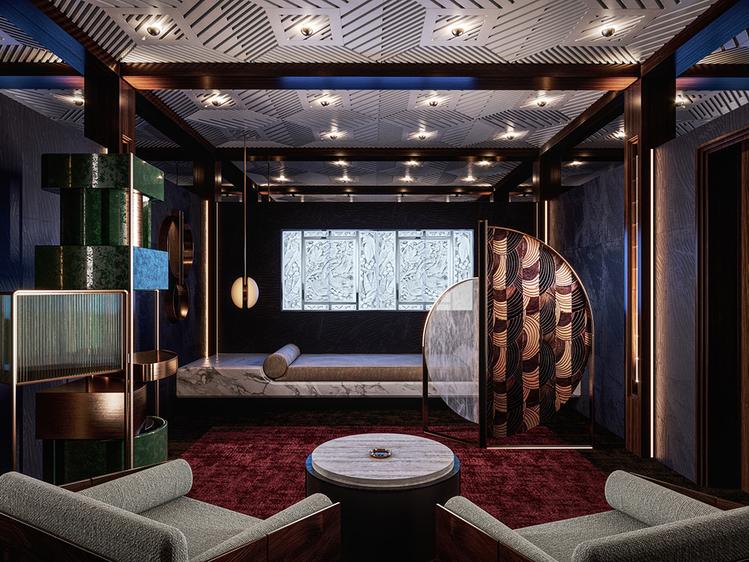 O Quarto de Fumagem Noturno – Humbert & Poyet. Carpete, paredes texturizadas e um teto entalhado fazem deste espaço um verdadeiro exemplo de neo-art déco. Estantes e prateleiras constroem a atmosfera intimista.