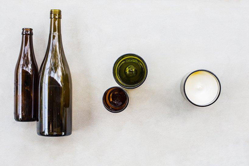 Velas de vidro feitas a partir de garrafas de vinho cortadas, que queimam bio-cera criada a partir do óleo de cozinha usado no próprio restaurante.