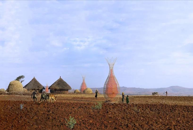 Campo agrícola com torres espalhadas. Cabanas ao fundo e agricultores caminhando