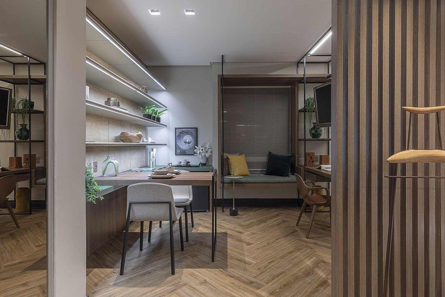 Suíte Cosmopolita - Marília Veiga. O ambiente integrado de 39m² atende às necessidades de jovem executivo, que precisa de um lugar para relaxar, fazer refeições, mas também dar continuidade aos seus trabalhos.