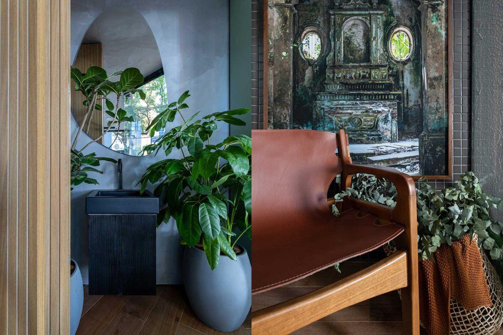 Pia preta com plantas em volta. Cadeira de madeira com assento em couro e pintura ao fundo