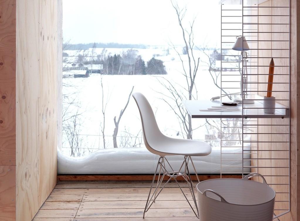 Cadeira eams branca com mesa branca e suportes metálicos