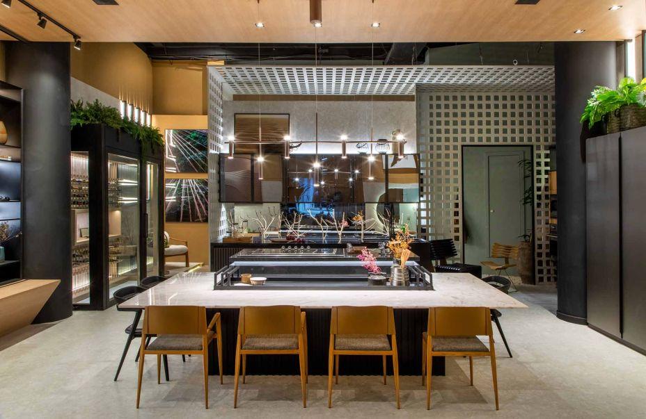 cozinha gourmet com ilha no centro e estilo industrial