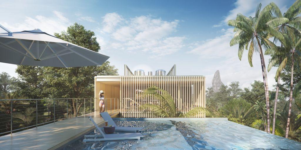 piscina de borda infinita com vista para natureza e espreguiçadeiras azuis da cor da água da piscina