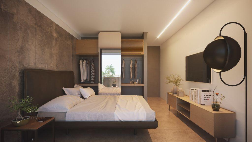 quarto com estilo industrial contendo rack em madeira clara, televisão, e um armário com espelho embutido